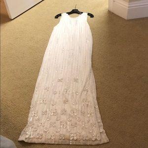 Parker. Black long white sequin gown